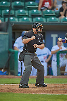 Umpire Nic Schmittou handles the calls behind the plate during the game between the Ogden Raptors and the Grand Junction Rockies at Lindquist Field on August 28, 2019 in Ogden, Utah. (Stephen Smith/Four Seam Images)