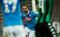 Napoli's Gonzalo Higuain celebrates after scoring during the  italian serie a soccer match,between SSC Napoli and Sassuolo    at  the San  Paolo   stadium in Naples  Italy , January 17, 2016