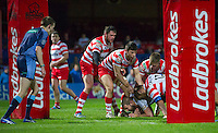 Picture by Allan McKenzie/SWpix.com - 17/04/2015 - Rugby League - Ladbrokes Challenge Cup - Wakefield Trinity Wildcats v Halifax RLFC - Rapid Solicitors Stadium, Wakefield, England - Wakefield's Nick Scruton is brought down just short of the try line by Halifax, Ladbrokes, branding.