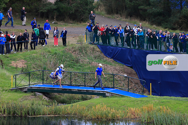 Henrik Stenson (EUR) crosses a bridge to the 16th green during the Sunday Singles Matches at the 2014 Ryder Cup at Gleneagles. The 40th Ryder Cup is being played over the PGA Centenary Course at The Gleneagles Hotel, Perthshire from 26th to 28th September 2014.<br /> Picture:  Thos Caffrey / www.golffile.ie