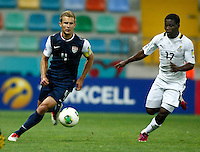Ghana's Ebenezer Assifuah (R) and USA's Caleb Stanko (L) during their FIFA U-20 World Cup Turkey 2013 Group Stage Group A soccer match Ghana betwen USA at the Kadir Has stadium in Kayseri on June 27, 2013. Photo by Aykut AKICI/isiphotos.com