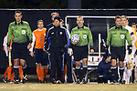 12 November 2013: Match Officials. From left: Assistant Referee Brandon Marion, Fourth Official Ross Cox, Referee Chris Penso, Assistant Referee Brian Miller. The Wake Forest University Demon Deacons hosted the University of Virginia Cavaliers at Spry Stadium in Winston-Salem, North Carolina in a 2013 NCAA Division I Men's Soccer match and the quarterfinals of the Atlantic Coast Conference tournament. Virginia won the game 1-0 in overtime.
