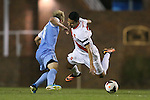 18 October 2013: Syracuse's Nick Perea (right) is fouled by North Carolina's Verneri Valimaa (left). The University of North Carolina Tar Heels hosted the Syracuse University Orangemen at Fetzer Field in Chapel Hill, NC in a 2013 NCAA Division I Men's Soccer match. UNC won the game 1-0.