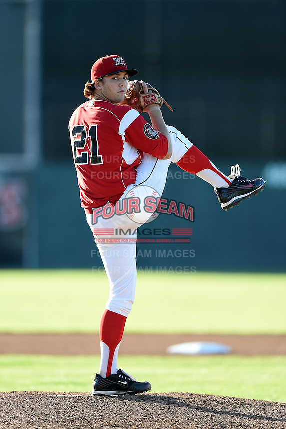 Batavia Muckdogs pitcher Michael Mader (21) delivers a warmup pitch during a game against the Lowell Spinners on July 16, 2014 at Dwyer Stadium in Batavia, New York.  Lowell defeated Batavia 6-4.  (Mike Janes/Four Seam Images)