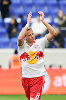 Jan Gunnar Solli (8) of the New York Red Bulls salutes the fans after the match. The New York Red Bulls defeated the Colorado Rapids 4-1 during a Major League Soccer (MLS) match at Red Bull Arena in Harrison, NJ, on March 25, 2012.