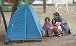 Afghan refugees play hide and seek behind a tent in a city park in Belgrade, Serbia. The park has filled with refugees from several countries stopping over on their way to Germany, Sweden, Holland, and elsewhere.