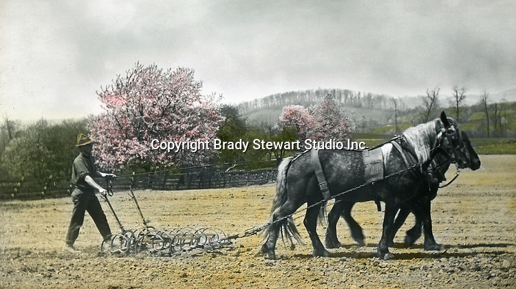Westmoreland County: Farmer tilling the soil off the Greensburg Turnpike - 1906.  To give family and friends a better feel for the adventure, he hand-color black and white negatives into full-color 3x4 lantern slides.  The Process:  He contacted a negative with another negative to create a positive slide.  He then selected a fine brush and colors and meticulously created full color slides.