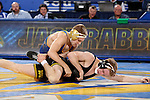 BROOKINGS, SD - DECEMBER 2:   Seth Gross from SDSU controls Phillip Laux  from Iowa in their 133 pound match Friday night at Frost Arena in Brookings, SD.(Photo by Dave Eggen/Inertia)