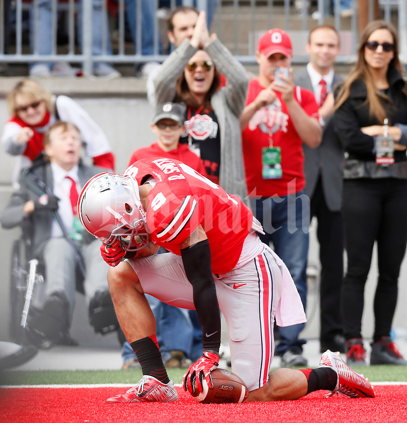 Ohio State Buckeyes wide receiver Devin Smith (9) kneels in the end zone after scoring a touchdown during Saturday's NCAA Division I football game against the Kent State Golden Flashes at Ohio Stadium in Columbus on September 13, 2014. Ohio State won the game 66-0. (Dispatch Photo by Barbara J. Perenic)