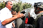 A Palestinian man scuffle with Israeli police, after arresting a Palestinian during clashes between Palestinian youth and the Israeli police in the east Jerusalem neighbourhood of Silwan on May 12, 2012. Israel is to reply on May 12, to a letter from Mahmud Abbas voicing the Palestinian president's grievances over the failed peace process, a senior Palestinian official said. Photo by Mahfouz Abu Turk