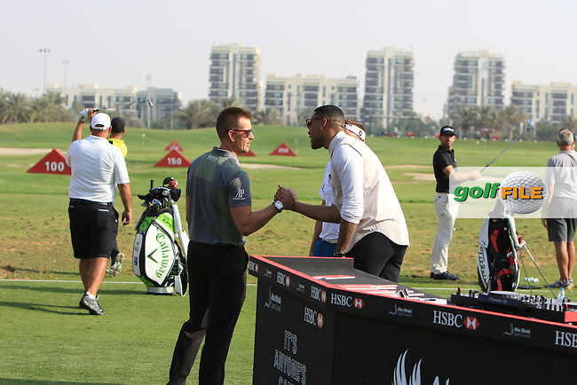 DJ Reggie Yates greets Henrik Stenson (SWE) during the &quot;Official Tournament Launch&quot;  on Tuesday Practice Day of the Abu Dhabi HSBC Championship on the 17th January 2017.<br /> Picture:  Thos Caffrey / Golffile<br /> <br /> All photo usage must carry mandatory copyright credit     (&copy; Golffile | Thos Caffrey)