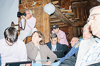 People listen as Republican presidential candidate and former Florida governor Jeb Bush speaks to a crowd in the barn of Dr. and Mrs. James Betti in Rye, New Hampshire, for former Massachusetts senator Scott Brown's No B.S. BBQ series.