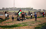 Palestinian protesters gather during clashes with Israeli troops in tents protest where Palestinians demand the right to return to their homeland at the Israel-Gaza border, in east of Gaza City on November 30, 2018. Photo by Dawoud Abo Alkas