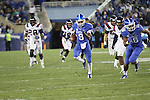 Freshman kicker Landon Foster runs down the field during the second half of the UK vs Samford at Commonwealth Stadium in Lexington, Ky., on Saturday, November 17th, 2012. Photo by Logan Douglas | Staff.