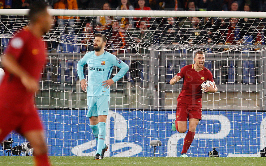 Roma s Edin Dzeko, right, celebrates past FC Barcelona Gerard Pique after scoring during the Uefa Champions League quarter final second leg football match between AS Roma and FC Barcelona at Rome's Olympic stadium, April 10, 2018.<br /> UPDATE IMAGES PRESS/Riccardo De Luca