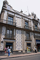 Window shoppers in front of the Casa de Azulejos in Mexico City. The House of Tiles now houses Sanborns department store and restaurant.