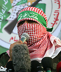 A Palestinian member of the al-Qassam Brigades, the armed wing of the Hamas movement, takes part in a military parade marking the first anniversary of the killing of Hamas's military commanders Mohammed Abu Shamala and Raed al-Attar, in Rafah in the southern Gaza Strip on August 21, 2015. Abu Shammala and al-Attar were killed by an Israeli air strike during the 50-day war between Israel and Hamas militants in the summer of 2014. Photo by Abed Rahim Khatib
