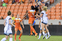 Houston, TX - Saturday July 08, 2017: Bruna Benites and Lindsey Horan go up for a header during a regular season National Women's Soccer League (NWSL) match between the Houston Dash and the Portland Thorns FC at BBVA Compass Stadium.