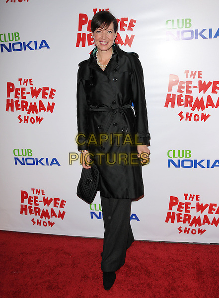ALLISON JANNEY.The The Pee-Wee Herman Show Opening Night held at Club Nokia at L.A. Live in Los Angeles, California, USA..January 20th, 2010.full length black max trench coat clutch bag .CAP/RKE/DVS.©DVS/RockinExposures/Capital Pictures.