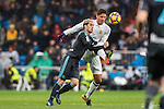 Juanmi Jimenez (l) of Real Sociedad battles for the ball with Raphael Varane of Real Madrid in action during their La Liga match between Real Madrid and Real Sociedad at the Santiago Bernabeu Stadium on 29 January 2017 in Madrid, Spain. Photo by Diego Gonzalez Souto / Power Sport Images