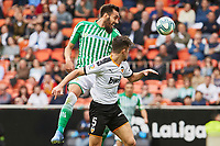 29th February 2020; Mestalla, Valencia, Spain; La Liga Football,Valencia versus Real Betis; Borja Iglesias of Real Betis wins the header over Garbiel Paulista of Valencia CF