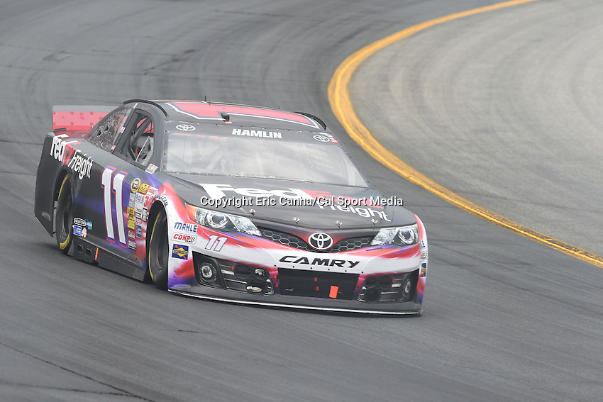July 13, 2014 - Loudon, New Hampshire, U.S. - Sprint Cup Series driver Denny Hamlin (11) races into a turn at the NASCAR Sprint Cup Series Camping World RV 301 race held at the New Hampshire Motor Speedway in Loudon, New Hampshire. Eric Canha/CSM