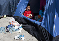 Pictured: A young boy plays with toys in his tent Monday 07 March 2016<br /> Re: Migrants have been gathering at the port of Piraeus, near Athens, Greece.
