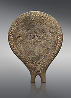 Cycladic terracotta 'frying pan' with incied decoration from  Syros. Early found  at Phylakopi, Melos. Cycladic period III 2300-2000 BC), National Archaeological Museum Athens, Cat No 6172.  Grey background.<br /> <br /> <br /> These so called 'frying pans' wre created by the Keros-Syros culture and are their useage is uncertain. The compex geometric patterns on their bases suggest that they may have had some symbolic meaning and were used in religious of magical rituals. They could also have served practical purposes being used as dishes, mirror mounts, astrolabes or metris measured for salt traders.