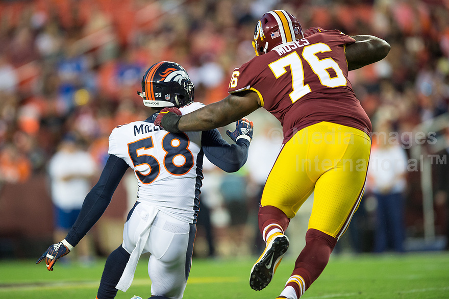 Landover, MD - August 24, 2018: Denver Broncos linebacker Von Miller (58) is held by Washington Redskins offensive tackle Morgan Moses (76) during preseason game between the Denver Broncos and Washington Redskins at FedEx Field in Landover, MD. The Broncos defeat the Redskins 29-17. (Photo by Phillip Peters/Media Images International)