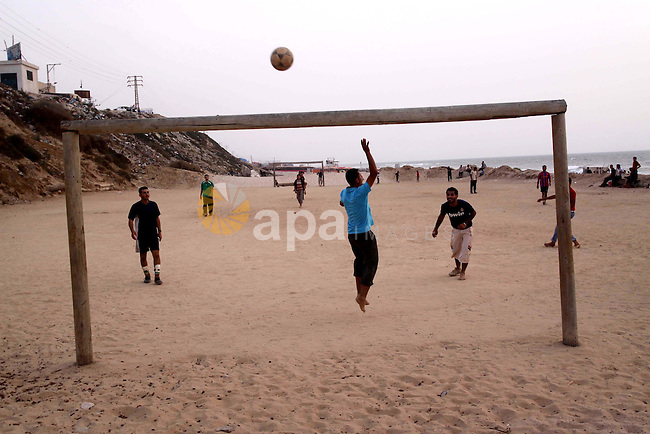 Palestinian youths play football at the beach of Gaza city on June 11,2010, in the first day of starting the World Cup 2010 in South Africa. Photo by Mohammed Asad