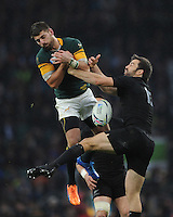 Damian de Allende of South Africa and Conrad Smith of New Zealand compete for the high ball during the Semi Final of the Rugby World Cup 2015 between South Africa and New Zealand - 24/10/2015 - Twickenham Stadium, London<br /> Mandatory Credit: Rob Munro/Stewart Communications
