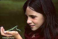 1M17-202z  Child looking at Chinese praying mantis nymph - Tenodera aridifolia sinensis
