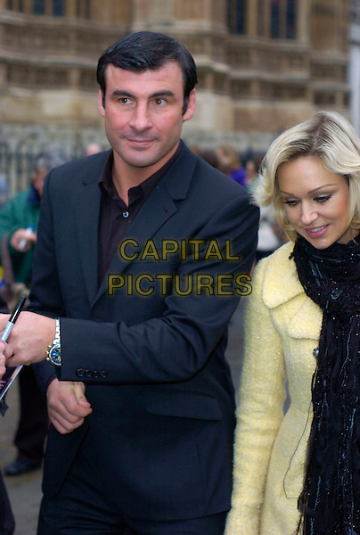 JOE CALZAGHE & KRISTINA RIHANOFF.at The Woman's Own Children Of Courage Award, Westminster Abbey, London, England, UK, .December 10th 2009..half length black grey gray yellow coat suit couple black scarf .CAP/DYL.©Dylan/Capital Pictures.