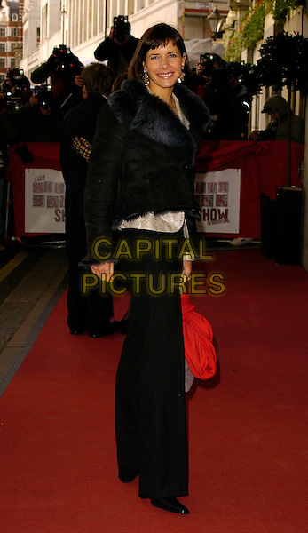 DARCEY BUSSELL.The South Bank Show Awards, Savoy Hotel, London, UK..January 23rd, 2007.full length black trousers jacket feather fur collar trim.CAP/CAN.©Can Nguyen/Capital Pictures