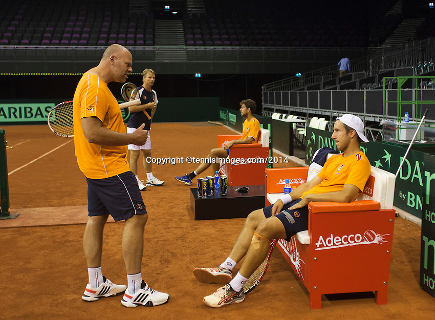 September 08, 2014,Netherlands, Amsterdam, Ziggo Dome, Davis Cup Netherlands-Croatia, Training Dutch  Team, Robin Haase and captain Jan Siemerink in the back, in front coach Raymond Knaap  and Igor Sijsling.<br />