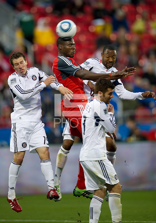 Toronto FC defender Dicoy Williams #31 jumps for a ball between three Chicago Fire players during an MLS game between the Chicago Fire and the Toronto FC at BMO Field in Toronto on May 14, 2011..The game ended in a 2-2 draw.