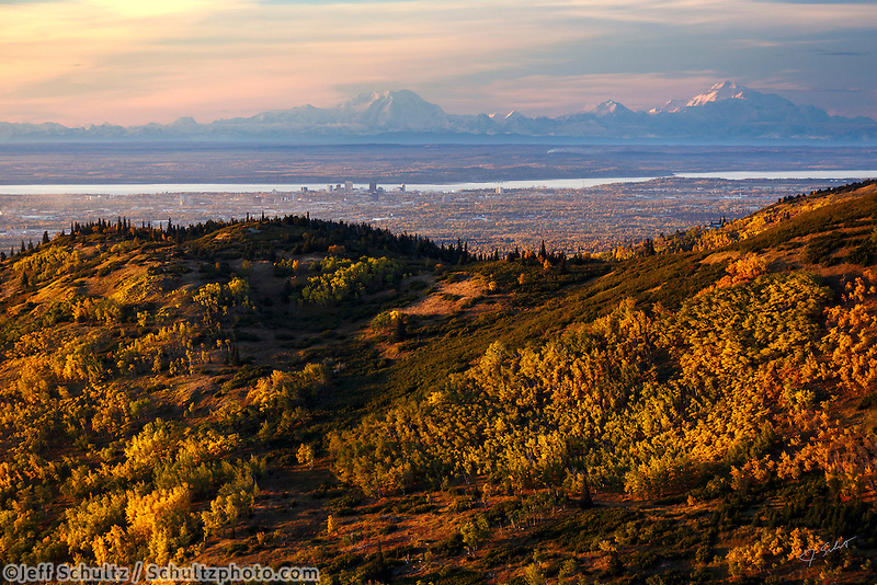 Fall landscape aerial view of  the Chugach Mountain foothills covered in fall colrors with downtown Anchorage, Alaska, JBER, Knik Arm with Denali / Mt. Mckinley and the Alaska Range in the background  September 2015