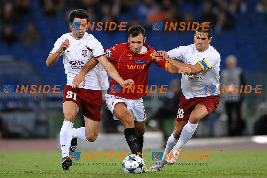 Mirko Vucinic (Roma) between Dani and Cadu' (Cluj)<br /> Roma 16/9/2008 Stadio &quot;Olimpico&quot; <br /> Champions league 2008/2009<br /> AS Roma - CFR Cluj (1-2)<br /> Foto Andrea Staccioli Insidefoto