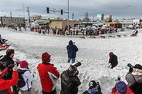 Crowds watch Wade Marrs as he rounds the turn at Cordova Street and 4th avenue during the Ceremonial Start of the 2016 Iditarod in Anchorage, Alaska.  March 05, 2016