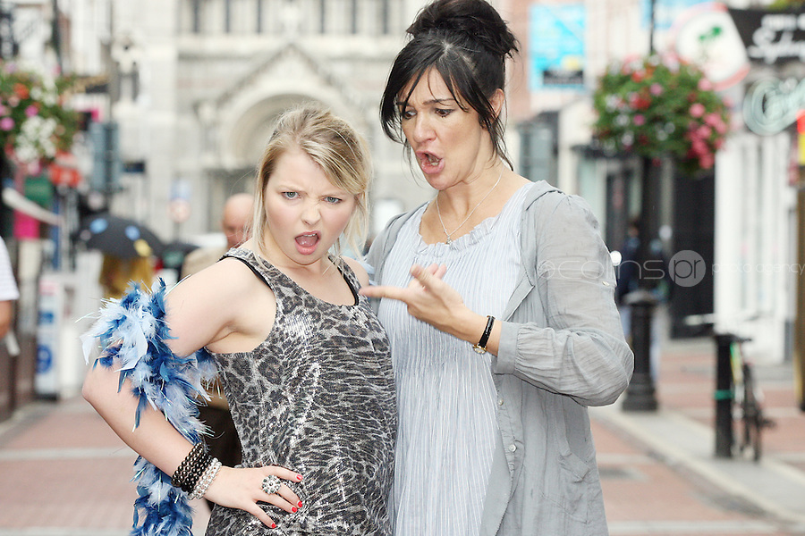 NO REPRO FEE 21/7/2010. Little Gem.  Hilda Fay, (BLACK HAIR)  and Genevieve Hulme-Beaman (BLONDE), the cast of Little Gem are pictured in the Westbury Hotel Dublin at the launch of Guna Nua's hit Little Gem set to sparkle in the Olympia Theatre for ten performances only. Hilda Fay makes her return as Lorraine, Anita Reeves continues in the role of Kay, and Genevieve Hulme-Beaman takes on the role of Amber. After sell-out seasons in New York, London and Paris and a sold-out 7-week run at Ireland's National Theatre, Gúna Nua is bringing its bittersweet comedy Little Gem back to Dublin for 10 shows only at The Olympia Theatre from August 26 to September 4, 2010. Love, sex, birth, death, dildos and salsa classes: Elaine Murphy's award winning Little Gem sees three generations of Dublin women on a wild and constantly surprising journey. Picture James Horan/Collins Photos