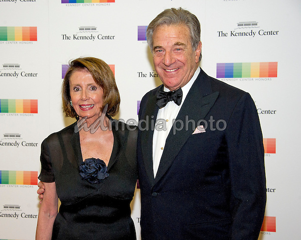 United States House Minority Leader Nancy Pelosi (Democrat of California) and her husband, Paul, arrive for the formal Artist's Dinner honoring the recipients of the 39th Annual Kennedy Center Honors hosted by United States Secretary of State John F. Kerry at the U.S. Department of State in Washington, D.C. on Saturday, December 3, 2016. The 2016 honorees are: Argentine pianist Martha Argerich; rock band the Eagles; screen and stage actor Al Pacino; gospel and blues singer Mavis Staples; and musician James Taylor. Photo Credit: Ron Sachs/CNP/AdMedia