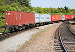 Freight train carrying containers on railway from port of Felixstowe, Suffolk, England