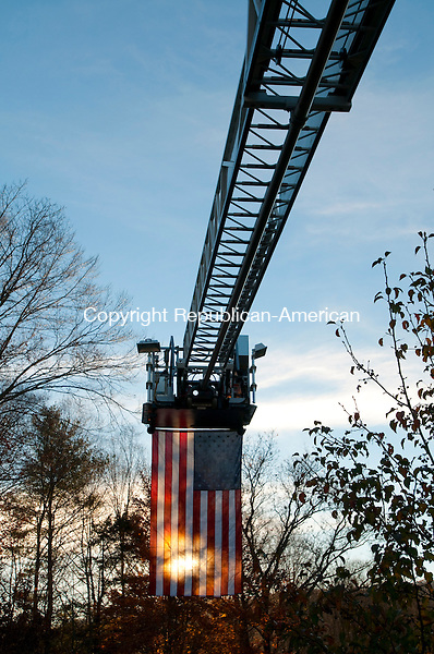 SOUTHBURY, CT, 05 NOVEMBER 2010-111010JS04--An American flag hangs off the ladder of a Southbury Volunteer Fire fire truck as part of a celebration returning  United State Air Force soldier Michael Thompson of Southbury back home Wednesday from his service in Afghanistan.<br />  Jim Shannon Republican-American