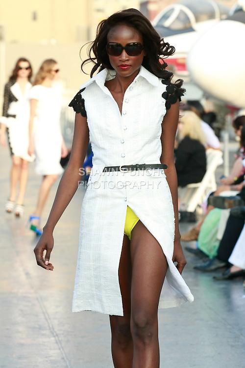 Aminata Niaria walks runway in a Douglas Hannant Resort 2012 outfit, on the USS Intrepid, June 7, 2011.