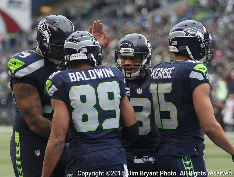 Seattle Seahawks quarterback Russell Wilson (3) celebrates with wide receiver Doug Baldwin after catching a six-yard touchdown against the Cleveland Browns at CenturyLink Field in Seattle, Washington on December 20, 2015. The Seahawks clinched their fourth straight playoff berth in four seasons by beating the Browns 30-13.  ©2015. Jim Bryant Photo. All Rights Reserved.