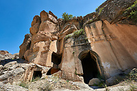 "Pictures & images of Kalburlu (St. Epthemios) church, 9th century, the Vadisi Monastery Valley, ""Manastır Vadisi"",  of the Ihlara Valley, Guzelyurt , Aksaray Province, Turkey.<br /> <br /> Kalburlu (St. Epthemios) church dates back to the 9th or 10th century. It is carved out of a single rock massive with rock columns holding up the roof of its church . The arches of Kalburlu (St. Epthemios) church have rich architectural decorated relif sculptures. The naves are connected by rounded arches & there is a baptismal font to the east of the main entrance."