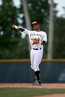 GCL Pirates shortstop Adrian Valerio (57) warmup throw to first during the first game of a doubleheader against the GCL Yankees 2 on July 31, 2015 at the Pirate City in Bradenton, Florida.  GCL Pirates defeated the GCL Yankees 2 2-1.  (Mike Janes/Four Seam Images)