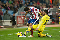Atletico de Madrid´s Arda Turan and Villarreal´s Jaume Costa during 2014-15 La Liga match between Atletico de Madrid and Villarreal at Vicente Calderon stadium in Madrid, Spain. December 14, 2014. (ALTERPHOTOS/Luis Fernandez) /NortePhoto