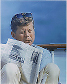 "United States President John F. Kennedy with cigar and New York Times aboard the ""Honey Fitz"" off Hyannisport, Massachusetts on August 31, 1963.<br /> Mandatory Credit: Cecil Stoughton/White House via CNP"