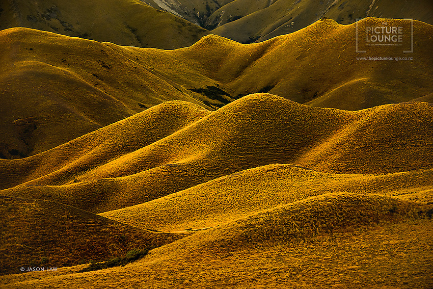 The beautiful tussock clad hills of the Lindis Pass are iconic in the New Zealand visual vernacular, captured beautifully here by Queenstown based landscape photographer Jason Law.